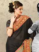 It is color this season and bright shaded suits are really something that is totally in vogue. This black chiffon jacquard saree is nicely designed with embroidered patch work is done with resham, zari and stone work. Saree gives you a singular and dissimilar look. Matching blouse is available. Slight color variations are possible due to differing screen and photograph resolution.