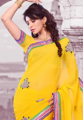 Try out this year top trend, glowing, bold and natural collection. This yellow chiffon saree is nicely designed with embroidered patch work is done with resham, zari, stone and lace work. Saree gives you a singular and dissimilar look. Matching blouse is available. Slight color variations are possible due to differing screen and photograph resolution.