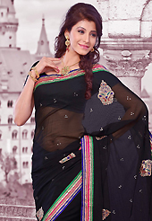 Dreamy variation on shape and forms compliment your style with tradition. This black chiffon saree is nicely designed with embroidered patch work is done with resham, zari, stone and lace work. Saree gives you a singular and dissimilar look. Matching blouse is available. Slight color variations are possible due to differing screen and photograph resolution.
