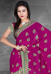 Let your personality articulate for you with this amazing embroidered saree. This magenta chiffon saree is nicely designed with embroidered patch work is done with resham, zari and stone work. Saree gives you a singular and dissimilar look. Matching blouse is available. Slight color variations are possible due to differing screen and photograph resolution.