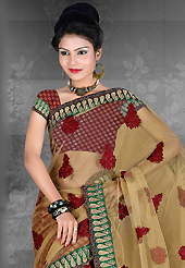 An casual wear perfect is ready to rock you. This fawn and maroon net and brocade saree is nicely designed with embroidered patch work is done with resham, zari and stone work. Saree gives you a singular and dissimilar look. Matching blouse is available. Slight color variations are possible due to differing screen and photograph resolution.