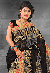 Try out this year top trend, glowing, bold and natural collection. This black chiffon saree is nicely designed with embroidered patch work is done with resham, zari, stone and lace work. Saree gives you a singular and dissimilar look. Matching blouse is available. Slight color variations are possible due to differing screen and photograph resolution.