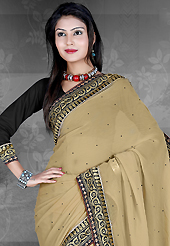 Take the fashion industry by storm in this beautiful embroidered saree. This dusty beige chiffon saree is nicely designed with embroidered patch work is done with resham, zari, stone and lace work. Saree gives you a singular and dissimilar look. Contrasting black blouse is available. Slight color variations are possible due to differing screen and photograph resolution.