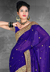 Elegance and innovation of designs crafted for you. This blue chiffon saree is nicely designed with embroidered patch work is done with resham, zari and stone work. Saree gives you a singular and dissimilar look. Matching blouse is available. Slight color variations are possible due to differing screen and photograph resolution.