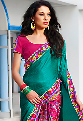 The glamorous silhouette to meet your most dire fashion needs. This teal green and dark pink jacquard and chiffon saree is nicely designed with flower print and embroidered patch work is done with zari, sequins and lace work. Beautiful embroidery work on saree make attractive to impress all. Matching blouse is available. Slight color variations are possible due to differing screen and photograph resolution.