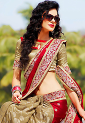 A desire that evokes a sense of belonging with a striking details. This red and dusty fawn satin and brasso saree is nicely designed with embroidered patch work is done with zari, stone and lace work. Beautiful embroidery work on saree make attractive to impress all. Matching blouse is available. Slight color variations are possible due to differing screen and photograph resolution.