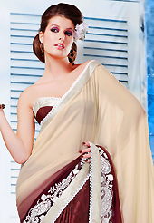 The evolution of style species collection spells pure femininity. This cream and brown chiffon and jacquard saree is nicely designed with embroidered patch work is done with resham and lace work. Beautiful embroidery work on saree make attractive to impress all. Matching blouse is available. Slight color variations are possible due to differing screen and photograph resolution.