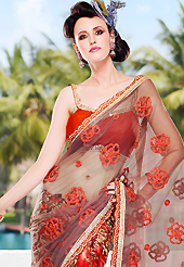 Welcome to the new era of Indian fashion wear. This light brown, green and red net and brosso saree is nicely designed with embroidered patch work is done with resham, zari, sequins and lace work. Beautiful embroidery work on saree make attractive to impress all. Matching blouse is available. Slight color variations are possible due to differing screen and photograph resolution.