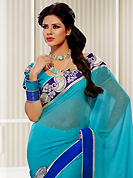 Ultimate collection of embroidery sarees with fabulous style. This light blue georgette saree have beautiful embroidery patch work which is embellished with resham, zari and stone work. Fabulous designed embroidery gives you an ethnic look and increasing your beauty. Matching blouse is available. Slight Color variations are possible due to differing screen and photograph resolutions.
