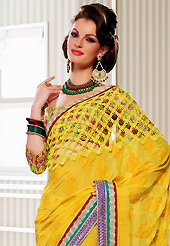 It is color this season and bright shaded suits are really something that is totally in vogue. This yellow georgette saree have beautiful embroidery patch work which is embellished with resham, zari and lace work. Fabulous designed embroidery gives you an ethnic look and increasing your beauty. Matching blouse is available. Slight Color variations are possible due to differing screen and photograph resolutions.