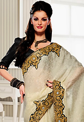Dreamy variation on shape and forms compliment your style with tradition. This off white crepe jacquard saree have beautiful embroidery patch work which is embellished with resham, zari and stone work. Fabulous designed embroidery gives you an ethnic look and increasing your beauty. Contrasting black blouse is available. Slight Color variations are possible due to differing screen and photograph resolutions.