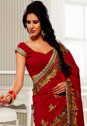 Get ready to sizzle all around you by sparkling saree. This maroon georgette saree have beautiful embroidery patch work which is embellished with resham, zari and stone work. Fabulous designed embroidery gives you an ethnic look and increasing your beauty. Matching blouse is available. Slight Color variations are possible due to differing screen and photograph resolutions.