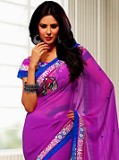 The glamorous silhouette to meet your most dire fashion needs. This fuchsia pink chiffon saree have beautiful embroidery patch work which is embellished with resham, zari, stone and lace work. Fabulous designed embroidery gives you an ethnic look and increasing your beauty. Matching blouse is available. Slight Color variations are possible due to differing screen and photograph resolutions.