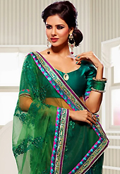 Welcome to the new era of Indian fashion wear. This green and bottle green net and crepe jacquard saree have beautiful embroidery patch work which is embellished with resham, zari, stone and lace work. Fabulous designed embroidery gives you an ethnic look and increasing your beauty. Matching blouse is available. Slight Color variations are possible due to differing screen and photograph resolutions.