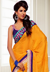 The traditional patterns used on this saree maintain the ethnic look. This dark yellow crepe jacquard saree have beautiful embroidery patch work which is embellished with resham, zari and lace work. Fabulous designed embroidery gives you an ethnic look and increasing your beauty. Contrasting purple blouse is available. Slight Color variations are possible due to differing screen and photograph resolutions.