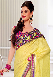 The most beautiful refinements for style and tradition. This yellow and deep pink jacquard and georgette saree have beautiful embroidery patch work which is embellished with resham, zari, stone and lace work. Fabulous designed embroidery gives you an ethnic look and increasing your beauty. Contrasting blue and pink blouse is available. Slight Color variations are possible due to differing screen and photograph resolutions.