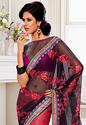 Your search for elegant look ends here with this lovely saree. This black and deep pink net and crepe jacquard saree have beautiful embroidery patch work which is embellished with resham, zari, sequins and lace work. Fabulous designed embroidery gives you an ethnic look and increasing your beauty. Contrasting magenta and black blouse is available. Slight Color variations are possible due to differing screen and photograph resolutions.