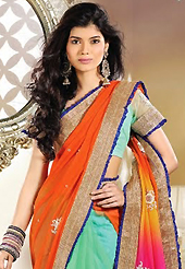 Let your personality articulate for you with this amazing embroidered saree. This orange, pink and sea green net and georgette saree is nicely designed with embroidery patch work is done with resham, zari, stone and lace work. Beautiful embroidery work on saree make attractive to impress all. This saree gives you a modern and different look in fabulous style. Matching blouse is available. Slight color variations are possible due to differing screen and photograph resolution.