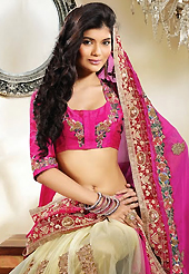 The most beautiful refinements for style and tradition. This pink and cream georgette and net lehenga style saree is nicely designed with embroidery patch work is done with resham, zari, stone, beads and lace work. Beautiful embroidery work on saree make attractive to impress all. This saree gives you a modern and different look in fabulous style. Matching blouse is available. Slight color variations are possible due to differing screen and photograph resolution.
