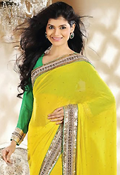 Try out this year top trend, glowing, bold and natural collection. This yellow georgette saree is nicely designed with embroidery patch work is done with zari, sequins, stone, beads and lace work. Beautiful embroidery work on saree make attractive to impress all. This saree gives you a modern and different look in fabulous style. Contrasting green blouse is available. Slight color variations are possible due to differing screen and photograph resolution.