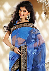 Exquisite combination of color, fabric can be seen here. This blue net saree is nicely designed with embroidery patch work is done with zari, stone, beads and lace work. Beautiful embroidery work on saree make attractive to impress all. This saree gives you a modern and different look in fabulous style. Matching blouse is available. Slight color variations are possible due to differing screen and photograph resolution.