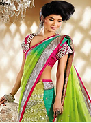 It is color this season and bright shaded suits are really something that is totally in vogue. This pastel green and green georgette and net lehenga style saree is nicely designed with embroidery patch work is done with resham, zari, sequins and stone work. Beautiful embroidery work on saree make attractive to impress all. This saree gives you a modern and different look in fabulous style. Contrasting dark pink raw silk blouse is available. Slight color variations are possible due to differing screen and photograph resolution.