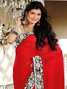 The glamorous silhouette to meet your most dire fashion needs. This red chiffon saree is nicely designed with embroidery patch work is done with resham and zari work. Beautiful embroidery work on saree make attractive to impress all. This saree gives you a modern and different look in fabulous style. Contrasting cream blouse is available. Slight color variations are possible due to differing screen and photograph resolution.