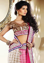 Let your personality articulate for you with this amazing embroidered saree. This pink and off white net and viscose saree is nicely designed with embroidery patch work is done with resham, zari and stone work. Beautiful embroidery work on saree make attractive to impress all. This saree gives you a modern and different look in fabulous style. Matching blouse is available. Slight color variations are possible due to differing screen and photograph resolution.