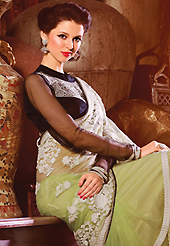Try out this year top trend, glowing, bold and natural collection. This light green net saree have beautiful embroidery patch work which is embellished with resham, zari and lace work. Fabulous designed embroidery gives you an ethnic look and increasing your beauty. Contrasting black blouse is available. Slight Color variations are possible due to differing screen and photograph resolutions.