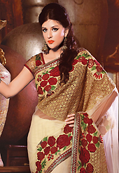 It is color this season and bright shaded suits are really something that is totally in vogue. This light fawn net saree have beautiful embroidery patch work which is embellished with resham, zari, stone, beads and lace work. Fabulous designed embroidery gives you an ethnic look and increasing your beauty. Matching blouse is available. Slight Color variations are possible due to differing screen and photograph resolutions.