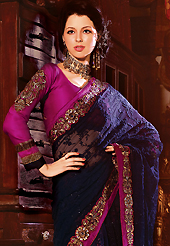 Take a look on the changing fashion of the season. This navy blue net lehenga style saree have beautiful embroidery patch work which is embellished with resham, zari, sequins and stone work. Fabulous designed embroidery gives you an ethnic look and increasing your beauty. Contrasting magenta blouse is available. Slight Color variations are possible due to differing screen and photograph resolutions.