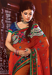 The traditional patterns used on this saree maintain the ethnic look. This red and orange faux georgette saree have beautiful embroidery patch work which is embellished with resham, zari, sequins, stone and lace work. Fabulous designed embroidery gives you an ethnic look and increasing your beauty. Contrasting dark blue blouse is available. Slight Color variations are possible due to differing screen and photograph resolutions.