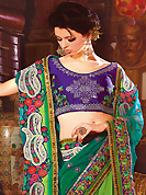 An occasion wear perfect is ready to rock you. This teal green and green faux georgette saree have beautiful embroidery patch work which is embellished with resham, zari, sequins and lace work. Fabulous designed embroidery gives you an ethnic look and increasing your beauty. Contrasting purple blouse is available. Slight Color variations are possible due to differing screen and photograph resolutions.