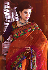 Let your personality articulate for you with this amazing embroidered saree. This rust, pink and green net and faux georgette lehenga style saree have beautiful embroidery patch work which is embellished with resham, zari, stone and beaded lace work. Fabulous designed embroidery gives you an ethnic look and increasing your beauty. Contrasting dark purple blouse is available. Slight Color variations are possible due to differing screen and photograph resolutions.