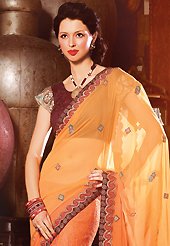 A desire that evokes a sense of belonging with a striking details. This shaded orange faux georgette saree have beautiful embroidery patch work which is embellished with resham, zari and stone work. Fabulous designed embroidery gives you an ethnic look and increasing your beauty. Contrasting dark brown blouse is available. Slight Color variations are possible due to differing screen and photograph resolutions.