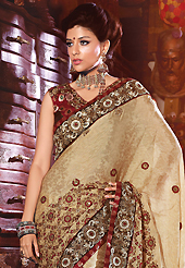 The evolution of style species collection spells pure femininity. This light fawn crepe jacquard saree have beautiful embroidery patch work which is embellished with resham, zari, sequins and stone work. Fabulous designed embroidery gives you an ethnic look and increasing your beauty. Contrasting maroon blouse is available. Slight Color variations are possible due to differing screen and photograph resolutions.