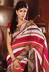 Try out this year top trend, glowing, bold and natural collection. This off white and magenta art silk saree have beautiful embroidery patch work which is embellished with resham work. Fabulous designed embroidery gives you an ethnic look and increasing your beauty. Contrasting red blouse is available. Slight Color variations are possible due to differing screen and photograph resolutions.