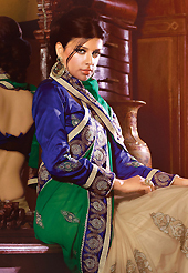 Dreamy variation on shape and forms compliment your style with tradition. This green and fawn faux chiffon and net saree have beautiful embroidery patch work which is embellished with resham, zari, sequins, stone and lace work. Fabulous designed embroidery gives you an ethnic look and increasing your beauty. Contrasting dark blue blouse is available. Slight Color variations are possible due to differing screen and photograph resolutions.