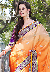 Dreamy variation on shape and forms compliment your style with tradition. This shaded orange faux satin georgette saree have beautiful embroidery patch work which is embellished with resham, zari, stone, beads and lace work. Fabulous designed embroidery gives you an ethnic look and increasing your beauty. Contrasting purple art silk blouse is available. Slight Color variations are possible due to differing screen and photograph resolutions.