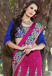 It is color this season and bright shaded suits are really something that is totally in vogue. This shaded dark pink faux georgette jacquard and net lehenga style saree have beautiful embroidery patch work which is embellished with resham, zari and stone work. Fabulous designed embroidery gives you an ethnic look and increasing your beauty. Contrasting blue art silk blouse is available. Slight Color variations are possible due to differing screen and photograph resolutions.