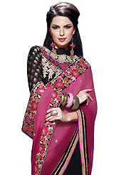 The traditional patterns used on this saree maintain the ethnic look. This shaded pink and black faux chiffon and faux georgette saree have beautiful gold print and embroidery patch work which is embellished with resham, zari, stone and lace work. Fabulous designed embroidery gives you an ethnic look and increasing your beauty. Matching black blouse is available. Slight Color variations are possible due to differing screen and photograph resolutions.