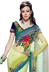 An occasion wear perfect is ready to rock you. This shaded light green net saree have beautiful embroidery patch work which is embellished with resham, zari, stone, applique and beads work. Fabulous designed embroidery gives you an ethnic look and increasing your beauty. Contrasting navy blue velvet blouse is available. Slight Color variations are possible due to differing screen and photograph resolutions.