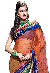Your search for elegant look ends here with this lovely saree. This orange and dusty green net and faux georgette saree have beautiful embroidery patch work which is embellished with resham, zari, sequins, stone and lace work. Fabulous designed embroidery gives you an ethnic look and increasing your beauty. Contrasting blue brocade blouse is available. Slight Color variations are possible due to differing screen and photograph resolutions.