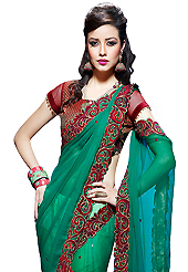 Exquisite combination of color, fabric can be seen here. This green faux chiffon and net lehenga style saree have beautiful embroidery patch work which is embellished with resham, zari, stone, beads and lace work. Fabulous designed embroidery gives you an ethnic look and increasing your beauty. Contrasting maroon blouse is available. Slight Color variations are possible due to differing screen and photograph resolutions.
