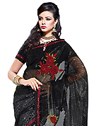 Take a look on the changing fashion of the season. This black and off white net and faux georgette saree have beautiful embroidery patch work which is embellished with resham and sequins work. Fabulous designed embroidery gives you an ethnic look and increasing your beauty. Matching blouse is available. Slight Color variations are possible due to differing screen and photograph resolutions.