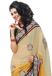 The traditional patterns used on this saree maintain the ethnic look. This cream and yellow crush georgette have beautiful embroidery patch work which is embellished with resham, zari, stone and beads work. Fabulous designed embroidery gives you an ethnic look and increasing your beauty. Contrasting green blouse is available. Slight Color variations are possible due to differing screen and photograph resolutions.