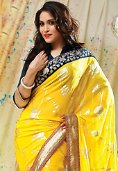 Take a look on the changing fashion of the season. This yellow faux chiffon saree have beautiful embroidery patch work which is embellished with resham and zari work. Fabulous designed embroidery gives you an ethnic look and increasing your beauty. Contrasting dark navy blue blouse is available. Slight Color variations are possible due to differing screen and photograph resolutions.