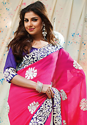 A desire that evokes a sense of belonging with a striking details. This dark pink faux chiffon saree have beautiful embroidery patch work which is embellished with resham and zari work. Fabulous designed embroidery gives you an ethnic look and increasing your beauty. Contrasting dark purple blouse is available. Slight Color variations are possible due to differing screen and photograph resolutions.