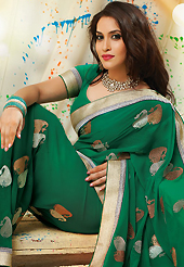 Your search for elegant look ends here with this lovely saree. This dark green faux chiffon saree have beautiful embroidery patch work which is embellished with zari work. Fabulous designed embroidery gives you an ethnic look and increasing your beauty. Matching blouse is available. Slight Color variations are possible due to differing screen and photograph resolutions.