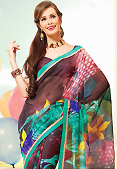 A desire that evokes a sense of belonging with a striking details. This beautiful dark brown and green super net saree is nicely designed with flower, dots print and graceful patch border. Beautiful print work on saree make attractive to impress all. It will enhance your personality and gives you a singular look. Matching blouse is available with this saree. Slight color variations are due to differing screen and photography resolution.